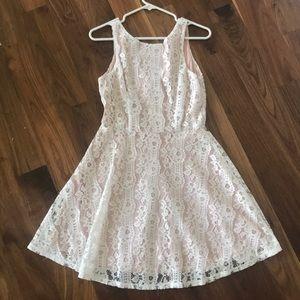 Nude underlay white lace overlay size med. dress.